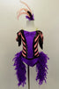 Pink & black chevron stripe off-shoulder leotard has purple bodice with sequin piping black fringe drop sleeves & feather boa. Comes with striped leggings & feather hair accessory. Front