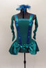 Teal dress has aqua suspender design & buttons. Attached satin bustle skirt has open front with bow details & wide back pleats. Has back bow matching head piece. Front