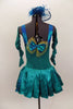 Teal dress has aqua suspender design & buttons. Attached satin bustle skirt has open front with bow details & wide back pleats. Has back bow matching head piece. Back