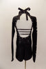 Long sleeved black biketard has high collar, low open back with 3 straps& crystals. Sleeves have silver zig-zag pattern and large jeweled bib. Has hair clip. Side