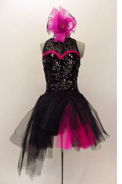 Costume has a black leotard base with lace back & upper & sequined front. Sweetheart neckline has hot-pink accent. BLack pull-on-tulle skirt has pink accent. Comes with large pink hair accessory. Front