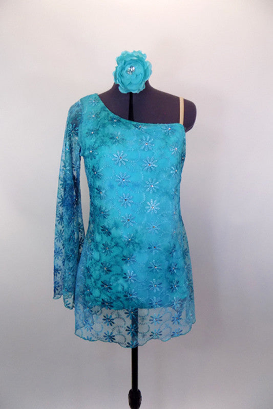 Single shoulder tunic dress has built in leotard & embroidered turquoise daisy flower lace with crystal accents in flower centers. Comes with hair accessory. Front
