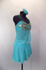 Aqua chiffon costume has silver sequins on bust of open sided baby-doll top. Skirt has layers of aqua chiffon over briefs. Comes with floral hair accessory. Right side
