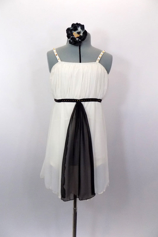 Ivory knee length chiffon dress has empire waist with gathered pleat bust. Has black velvet piping with amber crystals and long black center kerchief accent. Comes with hair accessory. Front