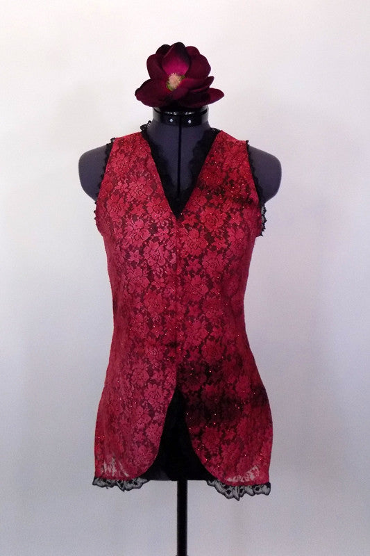 Sheer sparkle lace red tunic dress has V-neck & high front slit. Dress has black accent ruffle, black bra & briefs to go beneath. Comes with floral hair accessory. Front