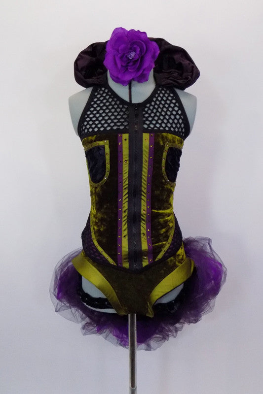 Costume has olive velvet vest-top with mesh halter neck & plum satin Elizabethan collar. Matching high-leg brief has elastic ruffle & plum bustle with black & purple tulle & green bow. Comes with purple floral hair accessory. Front