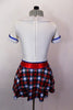 White schoolgirl style kilt dress has neck-tie collar, red crystal accent belt, blue piping & large crystal-jeweled buttons.Comes with bow hair accessory. Back