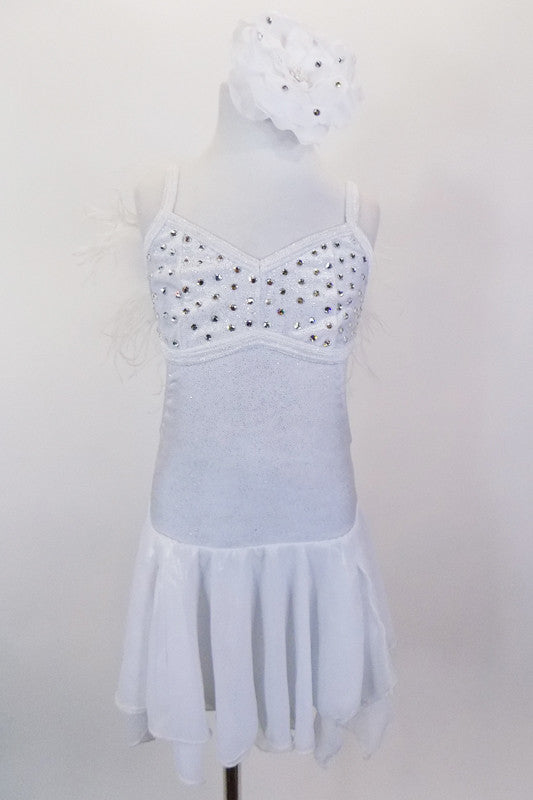 White sparkle leotard dress has layered chiffon skirt & crystal covered bust area. Shoulders are lined with white down feathers.  Comes with hair accessory. Front
