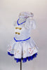 White sailor dress has princess cut seams, pouf sleeves and gold sailor buttons and hand painted anchor design over blue lace petticoat. Comes with sailor hat. Side
