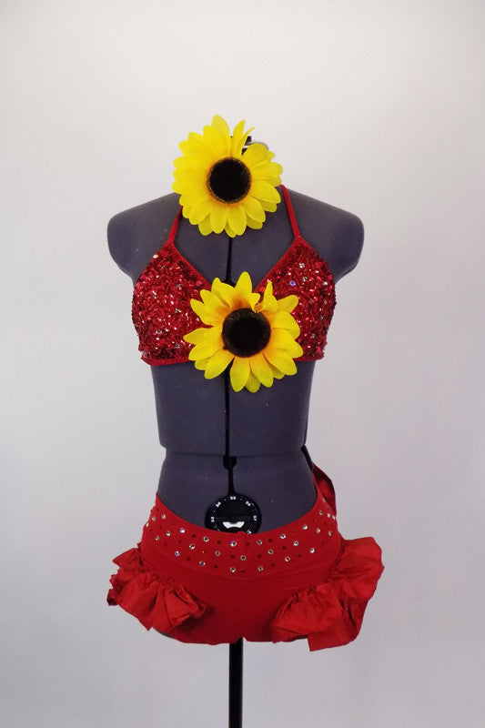 Two piece red costume has beaded triangle bra-top with large center sunflower. Ruffled brief has crystaled waistband & large back bow. Has sunflower hair piece. Front