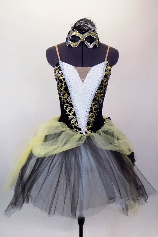 Romantic tutu has black velvet bodice with gold swirls, white inlay with crystals & gold braiding. Skirt is black-white base with pale yellow tulle overlay. Comes with matching mask and feather fan. Front