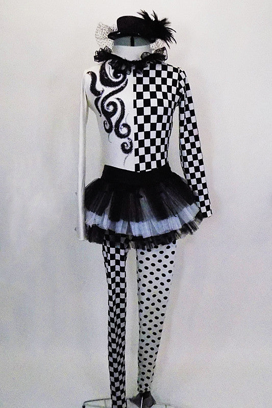 Costume is long sleeved high-neck leotard that is checkered on half with painted swirl design. Bottom is check & dot with layered tutu skirt. Has mini top hat. Front