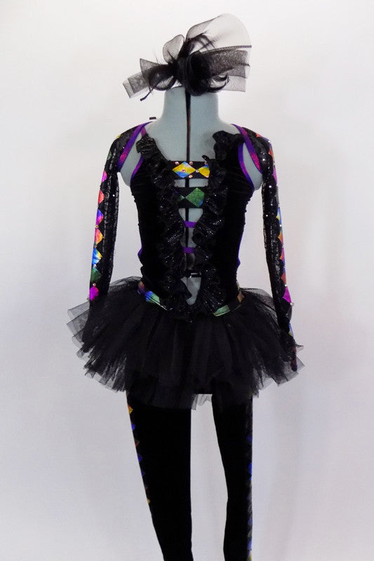 Black velvet unitard has black tutu skirt. Legs and sheer arms have colorful design lined with crystals. Bodice had low V-front held by straps & ruffled collar. Comes with hair accessory. Front