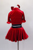 Red velvet skirt has ruffled black petticoat & crystaled waistband. Has red velvet short jacket over black crop-top with sequin accent. Has red velvet hair bow. Back