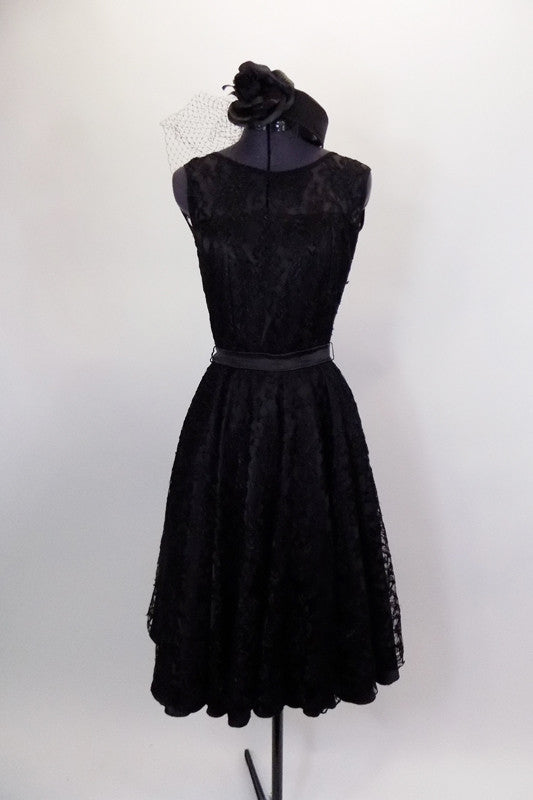 Black lace vintage dress had lace upper and open V-back. It is lined and has a full tulle petticoat & satin belt. Comes with matching veiled pill hat. Front