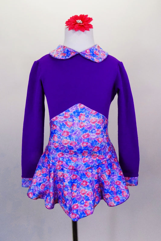 Purple stretch fleece skaters dress has long sleeves and a small floral print Peter Pan collar with matching high peak waist skirt. Comes with hair accessory. Front