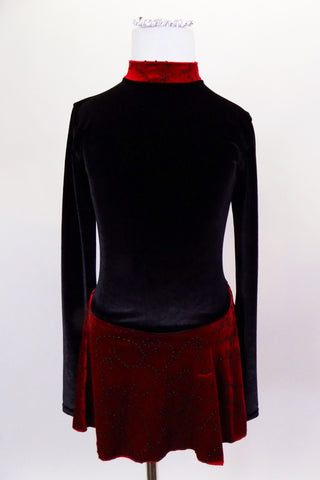 Black velvet skaters dress has long sleeves, high neck with red velvet band and keyhole back. Attached skirt is red with swirls of black beads. Comes with hair accessory. Front