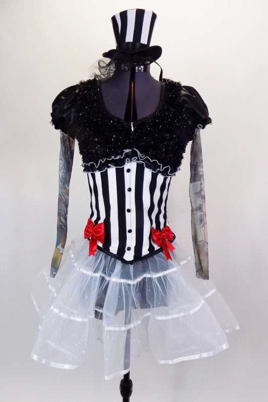 Black & white striped jacket has red bows, black  fur & tattoo sleeves with pouf.  Has white crystal tulle skirt with ribbon accent, attached black shorts & matching mini striped top hat. Front