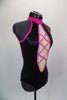 Black halter neck leotard has low back with pink collar, straps & piping covered in crystals. Front has nude center panel with crystalled criss-cross design. Comes with crystal hair barrette. Side