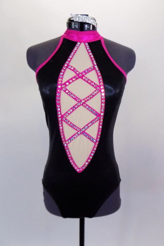 Black halter neck leotard has low back with pink collar, straps & piping covered in crystals. Front has nude center panel with crystalled criss-cross design. Comes with crystal hair barrette. Front