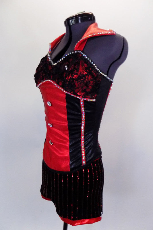 Black short has red sequined pin-stripes. The crystal covered red & black metallic bustier has lace-up back and faux red collar. Comes with bowler hat and gloves. Side
