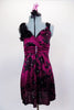 Silk magenta baby-doll dress has  black flower pattern with crystals.  Has wide straps with chiffon roses on shoulder. Comes with black shorts & hair accessory. Front
