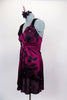Silk magenta baby-doll dress has  black flower pattern with crystals.  Has wide straps with chiffon roses on shoulder. Comes with black shorts & hair accessory. Left side