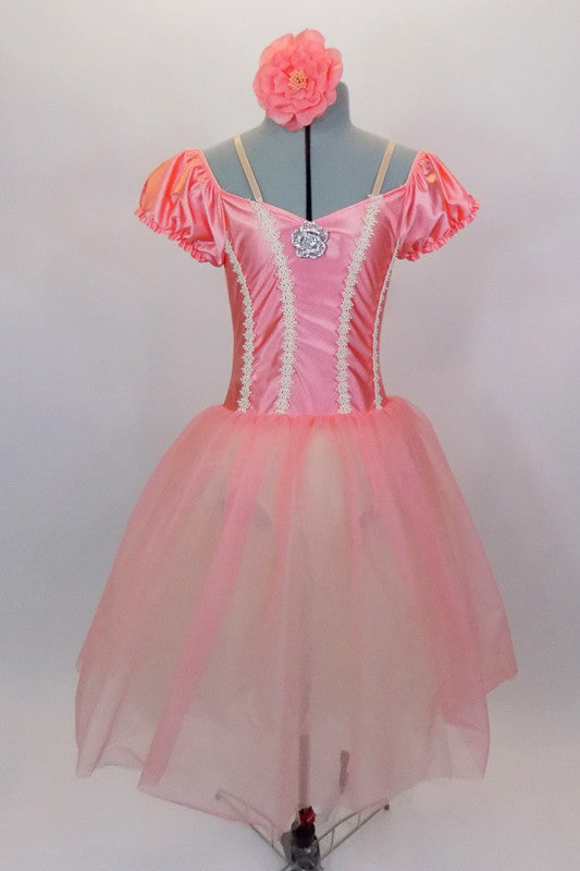 Romantic ballet tutu has layers of white tulle with peach overlay. The attached satin bodice has cream braiding along princess seam. Comes with floral hair accessory. Front