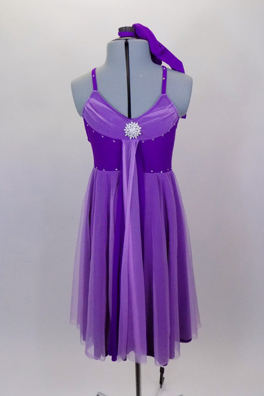 Purple knee length dress has crystal covered shoulder straps. Gathered lavender mesh covers neckline, skirt & center kerchief. Comes with panty & hair accessory. Front