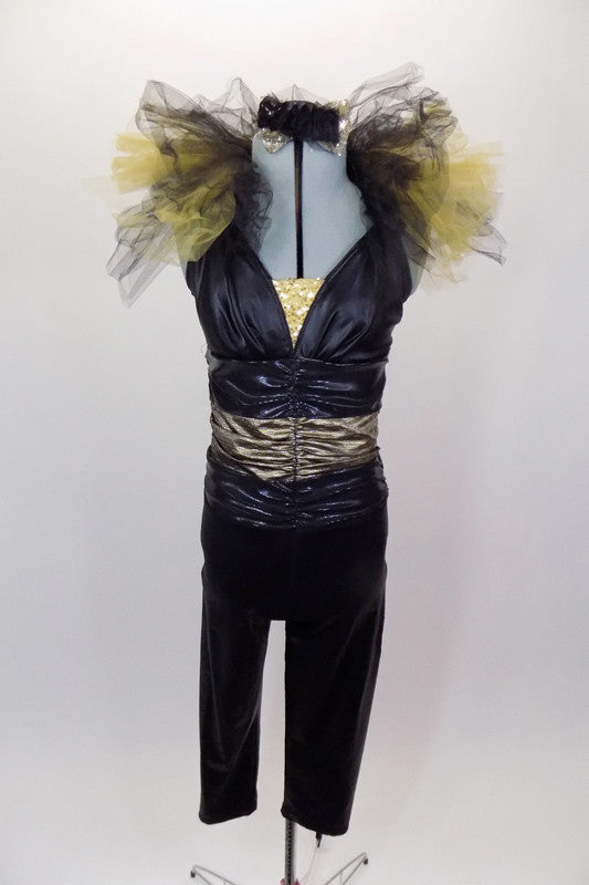 Black leather-look full unitard has triangle halter bra, wide gold waistband & open back.  The collar has layers of gold & black tulle tufting. Comes with hat. Front