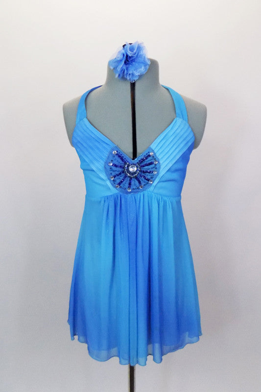 Blue chiffon halter baby-doll top has large jeweled applique at front center over pleated bust area & ties at neck. Comes with black shorts and hair accessory. Front