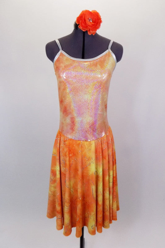 Orange & yellow dress has knee length flowing skirt with silver swirl detail. The bodice is an iridescent camisole with silver edging. Comes with hair accessory. Front