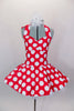 Red 50s style halter dress has white polka dot print. The attached white tricot underskirt adds volume. Has adjustable nude straps, attached briefs & hair accessory. Front