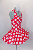 Red 50s style halter dress has white polka dot print. The attached white tricot underskirt adds volume. Has adjustable nude straps, attached briefs & hair accessory. Side