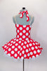 Red 50s style halter dress has white polka dot print. The attached white tricot underskirt adds volume. Has adjustable nude straps, attached briefs & hair accessory. Back