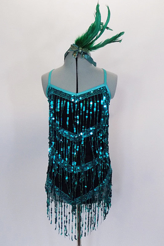 Teal sequin fringe details this sensational black matte jersey dress. Metallic binding trims the camisole neckline. Comes with built in leotard & hair accessory. Front