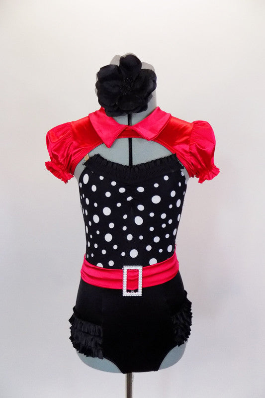 Leotard has black ruffled panty &  black bodice with white polka dots, ruffle & red belt with crystal buckle. Comes with red satin mini-shrug & hair accessory. Front
