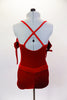 Red velvet leotard has off shoulder gather sleeves with ties & velvet shoulder straps. Bodice has three crystal hearts. Comes with shorts and hair accessory. Back