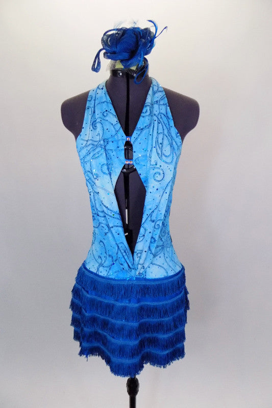 Aqua open front leotard dress has turquoise swirls. The open back halter bodice has front lapelled panels and crystaled back straps. Skirt is five layers of turquoise fringe. Comes with hair accessory. Front