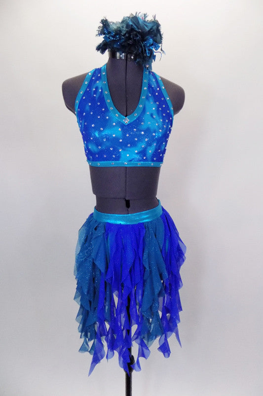 Costume is a halter neck, open back half top with splashes of blue-green & crystals. Bottom is brief with skirt of dangling mesh swirls. Has hair accessory. Front