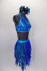 Costume is a halter neck, open back half top with splashes of blue-green & crystals. Bottom is brief with skirt of dangling mesh swirls. Has hair accessory. Right side