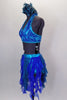 Costume is a halter neck, open back half top with splashes of blue-green & crystals. Bottom is brief with skirt of dangling mesh swirls. Has hair accessory. Left side