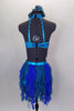 Costume is a halter neck, open back half top with splashes of blue-green & crystals. Bottom is brief with skirt of dangling mesh swirls. Has hair accessory. Back