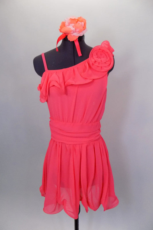 Coral chiffon lyrical dress has single shoulder & gathered waistband. The dress has ruffles along upper bodice. Comes with matching hair accessory. Front