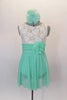 Empire waist dress has ivory lace bodice & shirred cummerbund with feather accent. Skirt is layers of mint green glitter mesh. Has matching hair accessory. Front