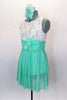 Empire waist dress has ivory lace bodice & shirred cummerbund with feather accent. Skirt is layers of mint green glitter mesh. Has matching hair accessory. Left side
