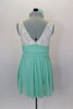 Empire waist dress has ivory lace bodice & shirred cummerbund with feather accent. Skirt is layers of mint green glitter mesh. Has matching hair accessory. Back