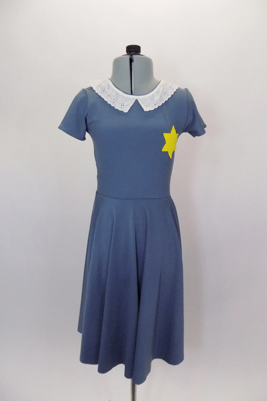Grey stretch dress has white eyelet collar & separate matching panties. The skirt portion comes to mid-calf & there is a yellow Star of David on the left bust. Front