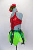 Themed costume has halter bodice in shape of strawberry with crystal seeds. Bodice is attached to green briefs with shades of green leaves. Comes with hat. Left side