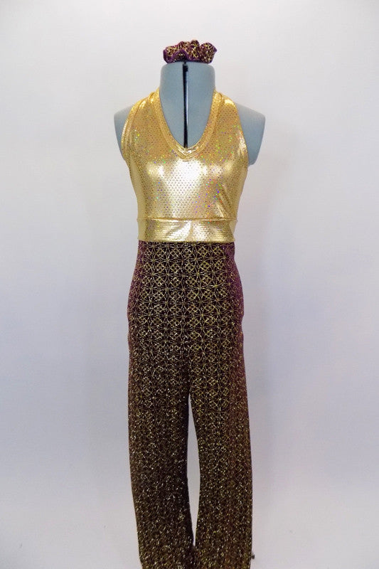 Burgundy & gold unitard has gold metallic speckled halter bust attached to burgundy velvet pants with gold spherical gothic glitter print. Has hair accessory. Front